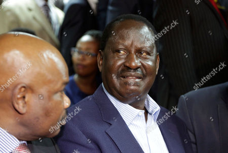 Opposition leader Raila Odinga, right, listens to the judgement at the Mililani low court in Nairobi, Kenya . A Kenyan judge has fined the country's interior minister, police chief and permanent secretary for immigration $2,000 each for contempt of court over the deportation of an opposition politician, Miguna Miguna