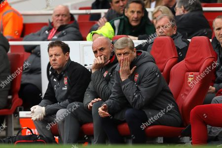 Manager of Arsenal, Arsene Wenger and his assistant, Steve Bould look on - Arsenal v Stoke City, Premier League, Emirates Stadium, London - 1st April 2018.