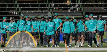 Australia's coach Darren Lehmann, leads the players during their training in Johannesburg, South Africa, ahead of their fourth cricket test match against South Africa