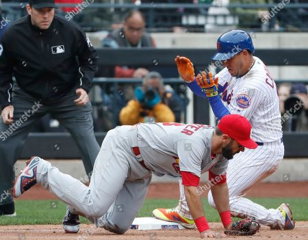 Chris Conroy, Asdrubal Cabrera. Third base umpire Chris Conroy, left, watches as New York Mets' Asdrubal Cabrera slides into third and St. Louis Cardinals first baseman Matt Carpenter (13) loses his balance on a stolen base during the ninth inning of an opening day baseball game, in New York