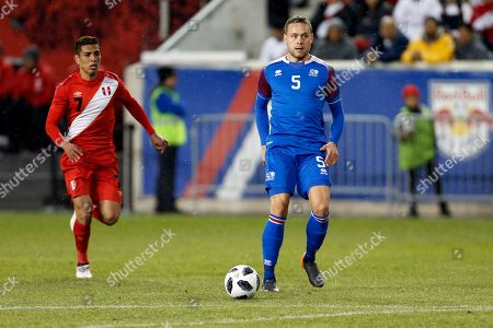 Iceland defender Sverrir Ingi Ingason in action against Peru during the second half of an international friendly soccer match, in Harrison, N.J. Peru won 3-1