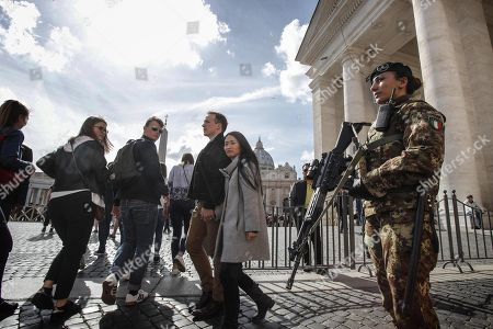 Stock Photo of Italian soldiers patrol in the area of St. Peter's Square at the Vatican, 29 March 2018. Italian Interior Minister Marco Minniti called for an ulterior reinforcement of security checks at crowded places during the Easter holidays.