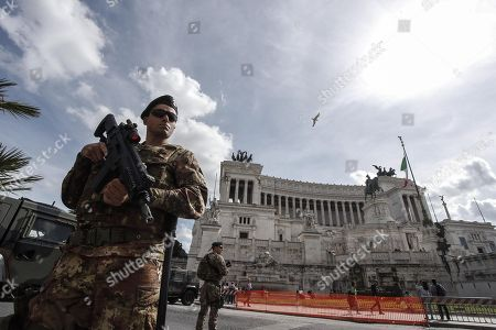 Stock Image of Italian soldiers patrol in Venice Square, central Rome, Italy, 29 March 2018.  Italian Interior Minister Marco Minniti called for an ulterior reinforcement of security checks at crowded places during the Easter holidays.