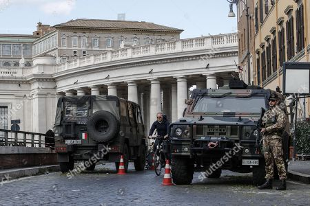 Italian soldiers patrol in Sant'Uffizio Square, Rome, Italy, 29 March 2018. Italian Interior Minister Marco Minniti called for an ulterior reinforcement of security checks at crowded places during the Easter holidays.