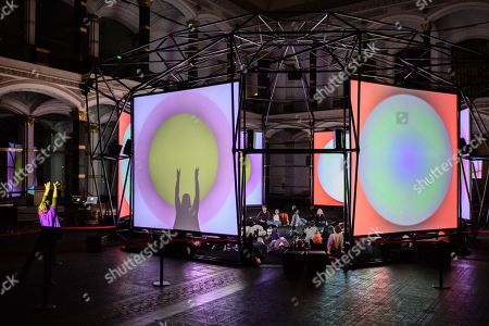 Visitors experience the installation 'Empty Formalism' by British musician Brian Eno during the public opening of the ISM Hexadome in the yard of the Gropius Bau venue in Berlin, Germany, 29 March 2018. The 'ISM Hexadome - Immersive architecture for sound and video art' event runs from 29 March to 22 April.