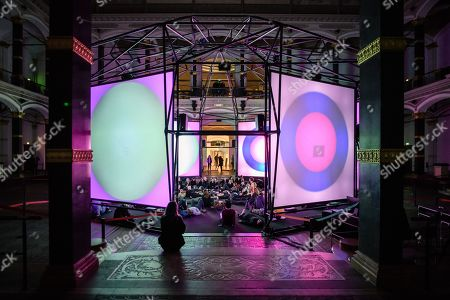 A visitor sits in front of the installation 'Empty Formalism' by British musician Brian Eno during the public opening of the ISM Hexadome in the yard of the Gropius Bau venue in Berlin, Germany, 29 March 2018. The 'ISM Hexadome - Immersive architecture for sound and video art' event runs from 29 March to 22 April.