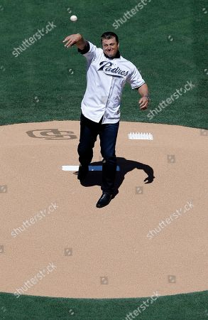Former San Diego Padre Trevor Hoffman throws out the first ceremonial pitch before an opening day baseball game against the Milwaukee Brewers in San Diego