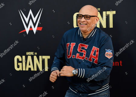"Comedian Larry Wilmore poses at the premiere of the HBO documentary film ""Andre the Giant"" at the ArcLight Hollywood, in Los Angeles. The film explores the life of World Wrestling Entertainment legend Andre Rene Roussimoff"