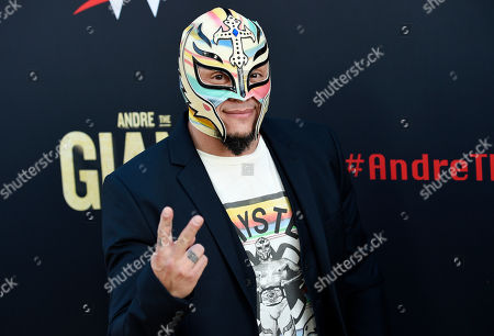"""Professional wrestler Rey Mysterio poses at the premiere of the HBO documentary film """"Andre the Giant"""" at the ArcLight Hollywood, in Los Angeles. The film explores the life of World Wrestling Entertainment legend Andre Rene Roussimoff"""