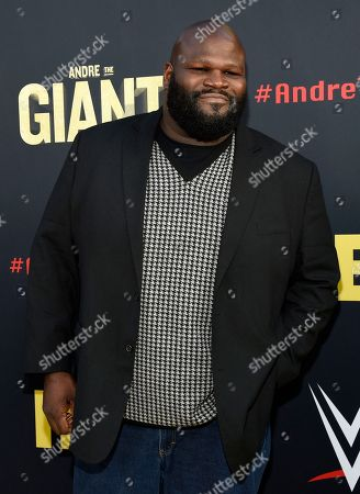"""Professional wrestler Mark Henry poses at the premiere of the HBO documentary film """"Andre the Giant,"""" at the ArcLight Hollywood, in Los Angeles. The film explores the life of World Wrestling Entertainment legend Andre Rene Roussimoff"""