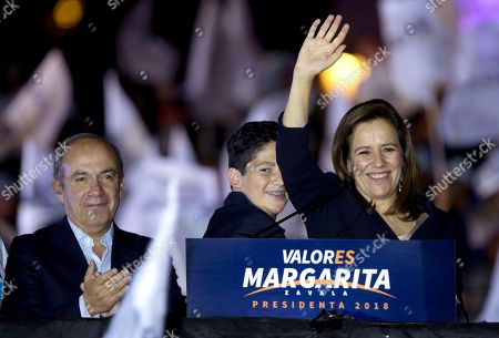 Margarita Zavala, Felipe Calderon. Former first lady and independent presidential candidate Margarita Zavala with Mexico's former President Felipe Calderon, left, waves to supporters during a rally at the start of her campaign for presidential election in Mexico City, early . Mexico will hold general elections on July 1