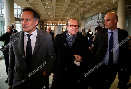 Lawyers for Laura Smet, daughter of late French rock singer Johnny Hallyday, from the left, Pierre-Olivier Sur, Herve Temime and Emmanuel Ravanas arrive at the courtroom in Nanterre, outside Paris, . In Friday's hearing, Johnny Hallyday's eldest children, are asking that the inheritance of their late father be frozen amid a legacy battle with their step-mother