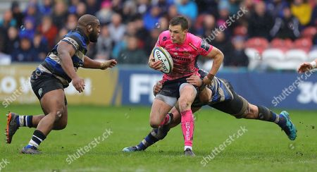 Joe Simmonds of Exeter Chiefs is tackled by James Phillips of Bath Rugby and Beno Obano of Bath Rugby during the Anglo Welsh Cup Final Match between Bath Rugby and Exeter Chiefs at Kingsholm Stadium, Gloucester, Gloucestershire on March 30.