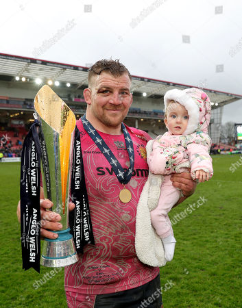 Moray Low of Exeter Chiefs with his daughter and the winners trophy after the Anglo Welsh Cup Final Match between Bath Rugby and Exeter Chiefs at Kingsholm Stadium, Gloucester, Gloucestershire on March 30.