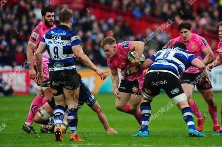 Stuart Townsend of Exeter Chiefs is tackled by James Phillips of Bath Rugby during the Anglo Welsh Cup Final Match between Bath Rugby and Exeter Chiefs at Kingsholm Stadium, Gloucester, Gloucestershire on March 30.