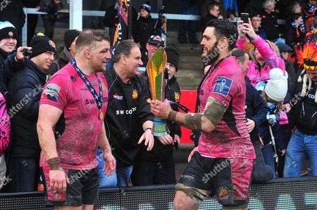 Moray Low of Exeter Chiefs and Dave Dennis of Exeter Chiefs celebrates after winning with fans during the Anglo Welsh Cup Final Match between Bath Rugby and Exeter Chiefs at Kingsholm Stadium, Gloucester, Gloucestershire on March 30.