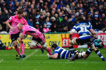 Matt Kvesic of Exeter Chiefs is tackled by James Phillips of Bath Rugby during the Anglo Welsh Cup Final Match between Bath Rugby and Exeter Chiefs at Kingsholm Stadium, Gloucester, Gloucestershire on March 30.