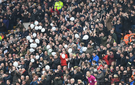 Stock Photo of Fulham fans release balloons in the 20th minute to mark the 20th anniversary of the murder of Fulham fan Matthew Fox at an match away to Gilingham
