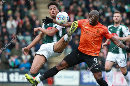 Zac Vyner of Plymouth Argyle battles for the ball with Marc-Antoine Fortune of Southend United during the Sky Bet League 1 match between Plymouth Argyle and Southend United on Friday 30th March 2018 at Home Park, Plymouth, Devon