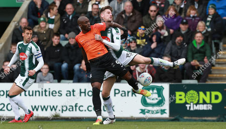 Sonny Bradley of Plymouth Argyle challenges for the ball with Marc-Antoine Fortune of Southend United during the Sky Bet League 1 match between Plymouth Argyle and Southend United on Friday 30th March 2018 at Home Park, Plymouth, Devon