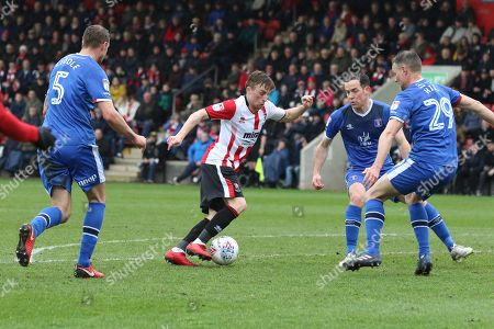 Joe Morrell and Clint Hill  during the EFL Sky Bet League 2 match between Cheltenham Town and Carlisle United at LCI Rail Stadium, Cheltenham. Picture by Antony Thompson