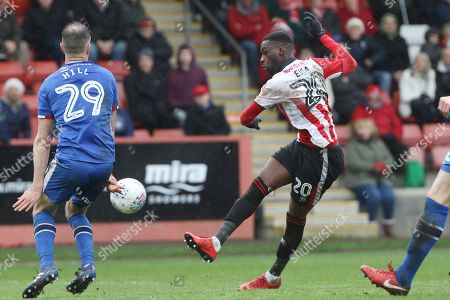 Clint Hill blocks a Mohamed Eisa shot  during the EFL Sky Bet League 2 match between Cheltenham Town and Carlisle United at LCI Rail Stadium, Cheltenham. Picture by Antony Thompson