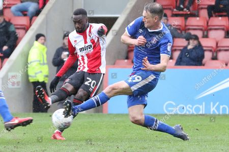 Mohamed Eisa and Clint Hill  during the EFL Sky Bet League 2 match between Cheltenham Town and Carlisle United at LCI Rail Stadium, Cheltenham. Picture by Antony Thompson