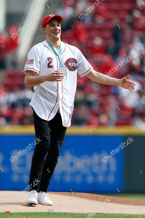 Stock Photo of United States Olympic Winter Games slopestyle skier and silver medalist Nick Goepper reacts after throwing the ceremonial first pitch before an opening day baseball game between the Cincinnati Reds and the Washington Nationals, in Cincinnati