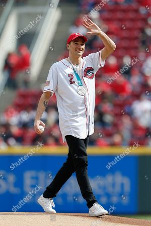 United States Olympic Winter Games slopestyle skier and silver medalist Nick Goepper takes the mound to throw out the ceremonial first pitch before an opening day baseball game between the Cincinnati Reds and the Washington Nationals, in Cincinnati