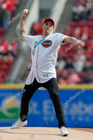 United States Olympic Winter Games slopestyle skier and silver medalist Nick Goepper throws the ceremonial first pitch before an opening day baseball game between the Cincinnati Reds and the Washington Nationals, in Cincinnati