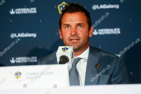 LA Galaxy's president Chris Klein speaks during a press conference introducing the team's newest player Zlatan Ibrahimovic of Sweden, following a training session at the StubHub Center, in Carson, Calif