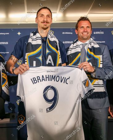 The Galaxy's newest player Zlatan Ibrahimovic, left, of Sweden, and team president Chris Klein pose with Ibrahimovic's new jersey during an MLS soccer press conference following a training session at the StubHub Center, in Carson, Calif