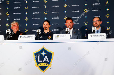 LA Galaxy's head coach Sigi Schmid, left, the Galaxy's newest player Zlatan Ibrahimovic of Sweden, team president Chris Klein and AEG president and CEO Dan Beckerman, in an MLS soccer press conference following a training session at the StubHub Center, in Carson, Calif