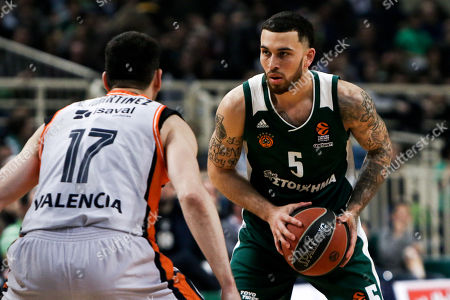 Stock Image of Mike James of Panathinaikos in action with Rafa Martinez (L) of Valecncia during the  Euroleague match between Panathinaikos and Valencia in Athens, Greece, 30 March 2018.