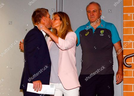 Former Australian cricket vice captain David Warner kisses his wife Candice before a press conference in Sydney, after being sent home from South Africa following a ball tampering scandal. Warner and captain Steve Smith were banned for 12 months while young batsman Cameron Bancroft received 9 months after an investigation into the Australian cricket team's cheating scandal identified Warner as the instigator of the ball tampering plan that unraveled in South Africa