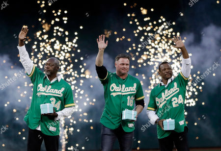 Dave Stewart, Jason Giambi, Rickey Henderson. Former Oakland Athletics players, from left to right, Dave Stewart, Jason Giambi and Rickey Henderson wave to the crowd during an introduction of the team's 50 greatest player before a baseball game against the Los Angeles Angels, in Oakland, Calif