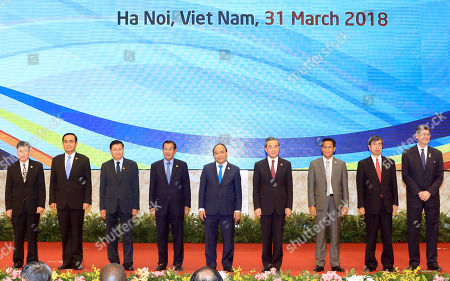 Mekong countries leaders; (L-R) ASEAN Secretary General Lim Jock Hoi, Thailand's Prime Minister Prayuth Chan-ocha, Laos' Prime Minister Thongloun Sisoulith, Cambodia's Prime Minister Hun Sen, Vietnam's Prime Minister Nguyen Xuan Phuc, Chinese State Councilor and Foreign Minister Wang Yi, Myanmar's Vice President Henry Van Thio, President of the Asian Development Bank Takehiko Nakao and Managing Director and World Bank Group Chief Financial Officer Joaquim Levy; pose for a photo before the start of the sixth Greater Mekong Sub-region Summit in Hanoi, Vietnam, 31 March 2018.  Vietnam is hosting the sixth Greater Mekong Sub-Region Summit (GMS-6) and 10th Cambodia-Laos-Vietnam Development Triangle Summit (CLV-10) from 30 to 31 March 2018 in Hanoi.