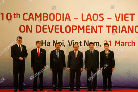 Leaders pose for a photo before the 10th Cambodia-Laos-Vietnam summit as part of the Greater Mekong Subregion Summit in Hanoi, Vietnam, 31 March 2018. From L-R are: Managing Director and World Bank Group Chief Financial Officer Joaquim Levy, President of the Asian Development Bank Takehiko Nakao, Cambodia's Prime Minister Hun Sen, Vietnam's Prime Minister Nguyen Xuan Phuc, Laos' Prime Minister Thongloun Sisoulith and ASEAN Secretary General Lim Jock Hoi.
