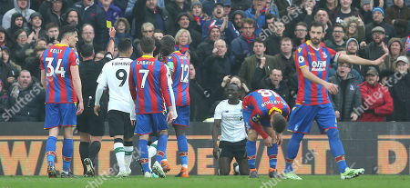 Sadio Mane of Liverpool is shown a yellow card from Referee, Neil Swarbrick for diving during the Premier League match between Crystal Palace and Liverpool on 31st March 2018 at Selhurst Park Stadium, Croydon, London.