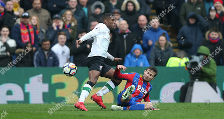 Yohan Cabaye of Crystal Palace tackles Georginio Wijnaldum of Liverpool during the Premier League match between Crystal Palace and Liverpool on 31st March 2018 at Selhurst Park Stadium, Croydon, London.