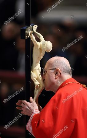 Stock Photo of Celebration of the Passion of the Lord. Adoration of the Holy Cross. Cardinal Tarcisio Bertone.