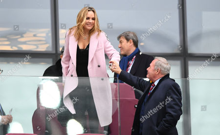 David Sullivan's wife greets Barry Fry from behind perspex
