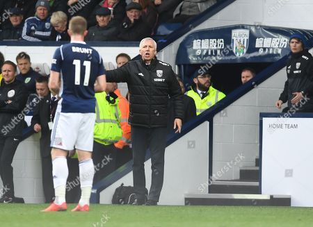 Alan Pardew manager of West Bromwich Albion speaks to Chris Brunt