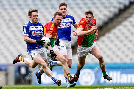 Carlow vs Laois. Laois' Ross Munnelly and Kieran Lillis with Chris Crowley and Jordan Morrissey of Carlow