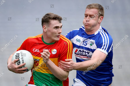 Carlow vs Laois. Carlow's Jordan Morrissey is tackled by Donal Kingston of Laois