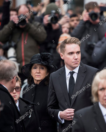 Jane Hawking (former wife) and Timothy Hawking (son) watch as the coffin leaves The funeral of Stephen Hawking at Church of St Mary the Great in Cambridge, Cambridgeshire.