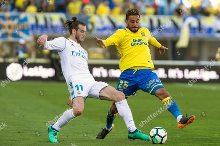 Stock Picture of Real Madrid's Gareth Bale (L) vies for the ball with UD Las Palmas' Alberto Aquilani (R)  during the Spanish Primera Division soccer match between UD Las Palmas and Real Madrid played at Gran Canaria stadium, in Las Palmas, Canary Islands, Spain, 31 March 2018.