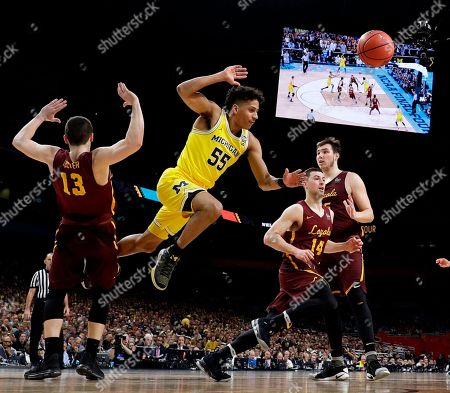 Michigan guard Eli Brooks (55) fights for a rebound with Loyola-Chicago's Clayton Custer (13) and Ben Richardson (14) during the first half in the semifinals of the Final Four NCAA college basketball tournament, in San Antonio