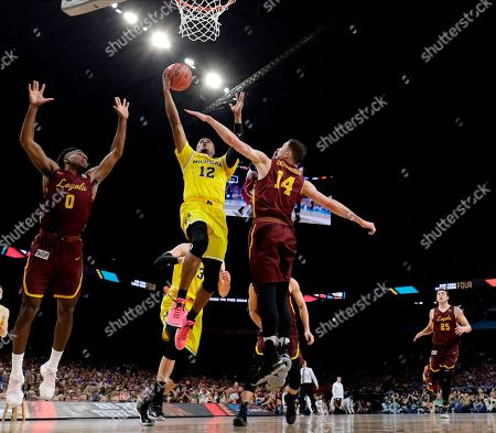 Michigan guard Muhammad-Ali Abdur-Rahkman (12) drives to the basket between Loyola-Chicago's Donte Ingram, left, and Ben Richardson during the second half in the semifinals of the Final Four NCAA college basketball tournament, in San Antonio