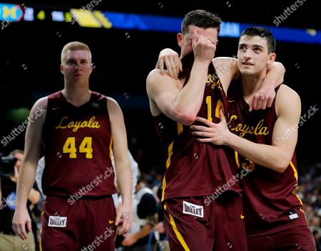 Loyola-Chicago's Ben Richardson embraces with Clayton Custer, right, after the semifinals of the Final Four NCAA college basketball tournament against Michigan, in San Antonio. Michigan won 69-57